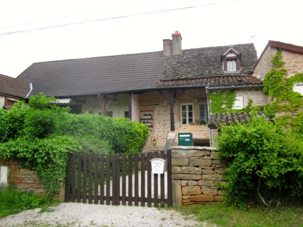 Balleure home handsomely refurbished, with newly-cleaned stone walls.