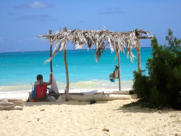 A bit of shade on a a vast stretch of beach.