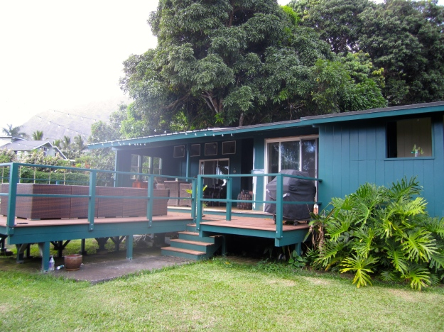 Out back: deck and guest quarters.