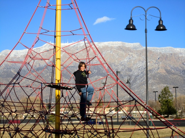 This is my grandson Quinn, 11, on a climbing structure we found on the hunt to catch unobstructed views of the Sandias.